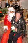 Everybody gets a chance on Santa's lap. Go Roberta Go!